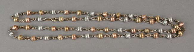 A 9ct tri-gold bead and link long neckla