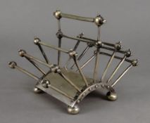 A Victorian folding tubular seven-bar toast rack, Hukin & Heath, designed by Dr.