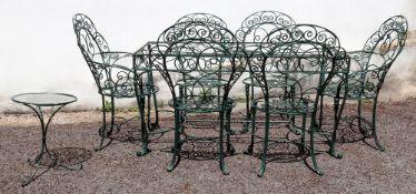 A rectangular green wrought metal garden table, 153cm wide x 77cm deep x 76cm high, lacks glass top,