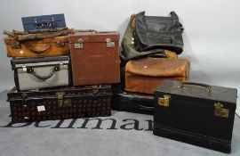 A quantity of mostly early 20th century travelling cases and bags, largest 68cm wide x 25cm high.
