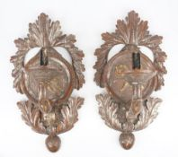 A pair of 19th century gilt/silvered wooden wall sconces,