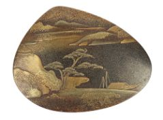 A Japanese gold lacquer kogo (incense container), of shell form, decorated with a river landscape,