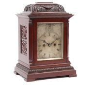 A Victorian mahogany cased mantel clock with silvered dial, subsidiary strike/silent,