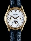 A Patek Philippe gold circular cased gentleman's calendar wristwatch,