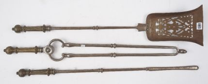 A set of three Georgian steel fire irons, each with fluted brass handles and knopped shafts, shovel,