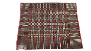 A Welsh woven blanket in brown red and white, central squared design, outer banded design,