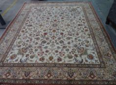 A part silk Ghom carpet, Persian, the ivory field with a minor central medallion, corner designs,