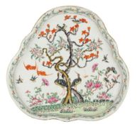 A Chinese famille rose tray, 19th century, of shaped trefoil form, painted with birds,