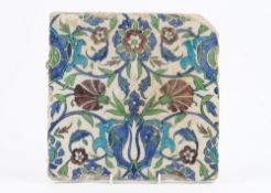 A large Iznik pottery tile, probably 18th century, painted in green,