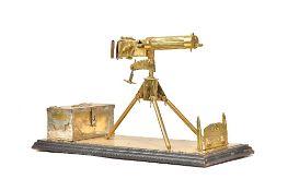 A brass model of a WWI Vickers machine gun, 20th century,