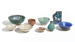 A group of Islamic pottery, circa 12th century and later, comprising; a turquoise glazed jug, 13.