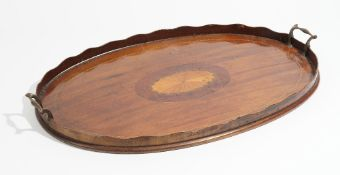 A 19th century marquetry inlaid oval serving tray, with wavy gallery, 67cm wide.