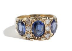 A gold, synthetic sapphire and diamond ring,