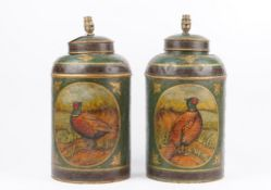 A pair of tole peinte lamps, early 20th century, detailed with pheasants against a green ground,