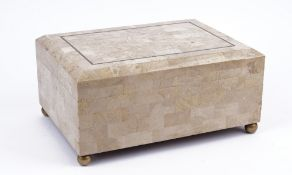 A tessellated marble cigar box by Maitland Smith, raised on spherical brass bun feet, 36cm wide.