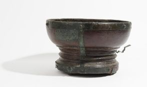 An 18th century metal mounted hardwood turned footed bowl, 36cm diameter x 22cm high.
