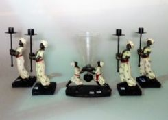 Four modern composition figural candle holders,