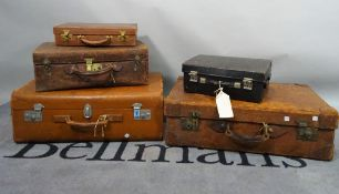 A collection of five 20th century suitcases and cases, mostly leather, various sizes,