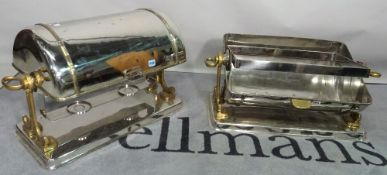 A pair of silver plated food warmers, 20th century, of domed form on a brass frame,