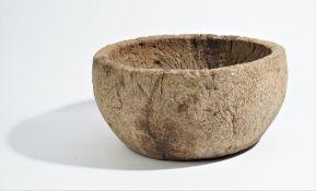 A circular dug out burr wood bowl, probably 19th century, 44cm diameter x 23cm high.
