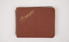 An album of twelve signatures, mostly cricket,