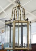 A Victorian style gilt metal hall lantern of hexagonal form,