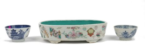 A Chinese famille-rose planter, 19th century, of oblong form raised on four bracket supports,