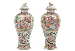 A pair of Canton famille-rose vases and covers, 19th century, of baluster form,