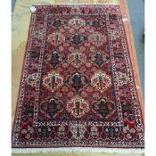 A Bidjar rug, Persian, the madder field with cartouches of trees and flowers,