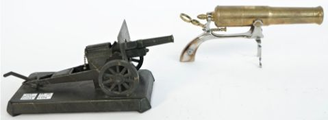 A brass novelty canon model on an iron pistol gripped frame, 20th century,