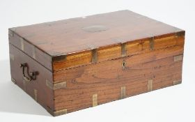 A 19th century Anglo-Indian brass bound teak travelling campaign table box, 57cm wide x 22cm high.