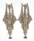 A pair of 19th century gilt bronze wall appliques, cast in the form of an exotic bird,