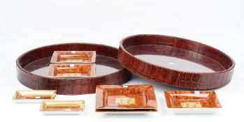 Two circular twin handled serving trays with faux crocodile skin bodies,
