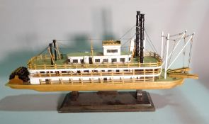 'The Queen of Mississipi', a modern wooden model of a paddle boat, 70cm wide x 35cm high.
