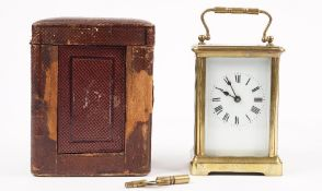 An early 20th century brass cased carriage clock with enamel dial,