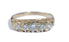 An 18ct gold and diamond five stone ring, set with a row of circular cut diamonds,