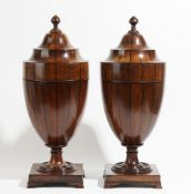 A pair of 19th century inlaid mahogany urn shaped pop-up knife boxes, on square bases,