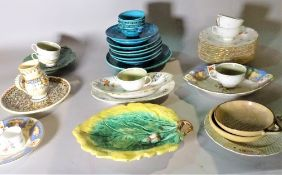 A group of mainly 20th century dinner services, a quantity of blue glaze plates and sundry.