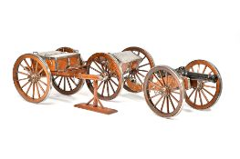A bronze model of a six pounder field gun with steel mounted walnut carriage and limbers,