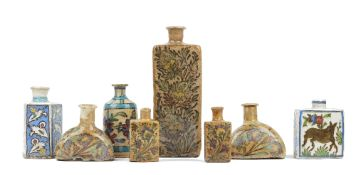 A group of eight Persian pottery flasks, 19th/20th century, of various form and size,