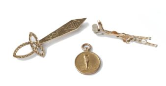 A gold and cultured pearl brooch, designed as two golf clubs, a 9ct gold fob medal,