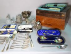 A quantity of assorted silver plated wares, including a canteen, flatware, toast rack and sundry,