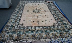 A Moroccan carpet, African, the pink field with a central medallion, minor motifs,