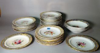 A 19th Century Berlin part dinner service decorated with floral and gilt.