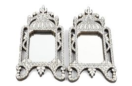 A pair of small Ottoman style mother-of- pearl mounted mirrors, 20th century,