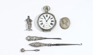 A base metal cased, keyless wind, openfaced Goliath watch, with a gilt jewelled lever movement,