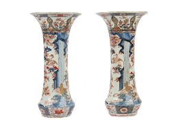 A pair of Japanese Imari trumpet vases, Edo period, late 17th century, painted in underglaze-blue,