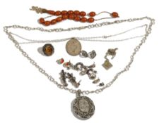 A group of mostly silver jewellery, comprising; a Victorian oval pendant locket,