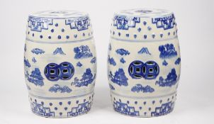 A pair of modern Chinese style blue and white garden seats, each decorated with landscape scenes,