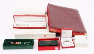 A Must de Cartier tri-colour stainless steel and gold plated money clip,